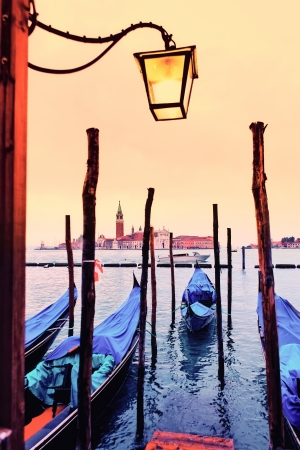 View of San Giorgio maggiore with gondolas. From San marco.  photo