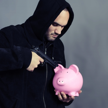 bad guy with pink piggy bang and gun in the hand photo