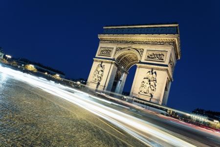 paris night: Arc de Triomphe by night with car lights, Paris