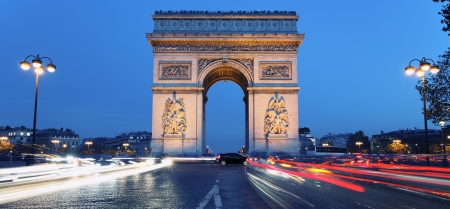 Panoramic view of Arc de Triomphe by night, France