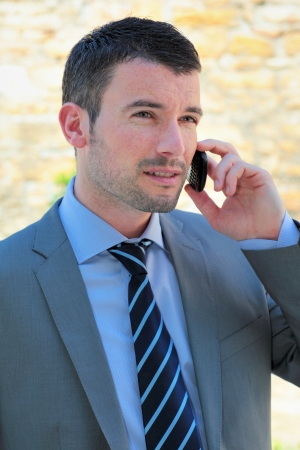 handsome man calling by phone outdoor photo