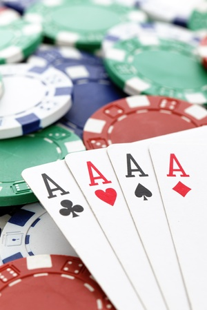 four of a kind: poker, four aces of a kind with chips background