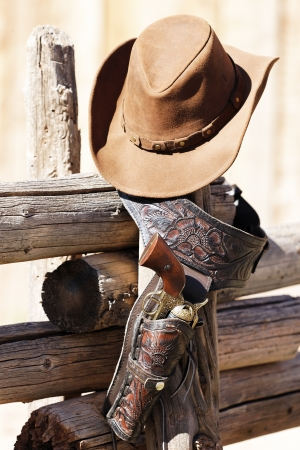 munition: gun and hat under sunlight Stock Photo