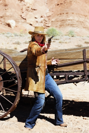 bad cowgirl with a gun in the hand photo