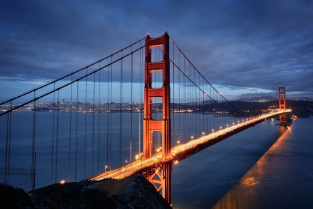 Night scene with Golden Gate Bridge and San Francisco lights photo