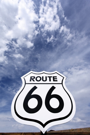 An old, antique, nostalgic route 66 sign and sky photo