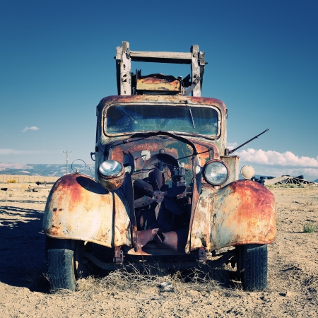 Old truck out in the desert photo