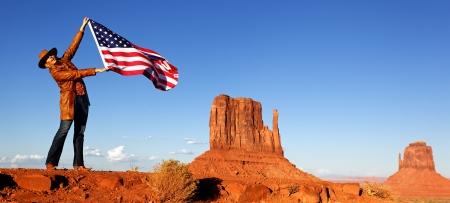 young woman holding USA flag at Monument Valley