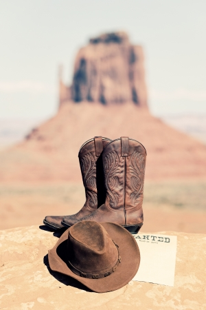 vintage wanted poster, boots and hat in Monument Valley photo