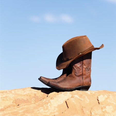 brown cowboy hat and boots outdoor photo