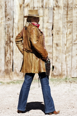 Portrait of a blond cowgirl  Western movie style  photo
