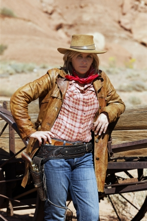 Portrait of beautiful cowgirl  Western movie style  photo
