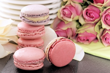 valentine day cup of coffee: wedding dessert with macaroons and roses Stock Photo