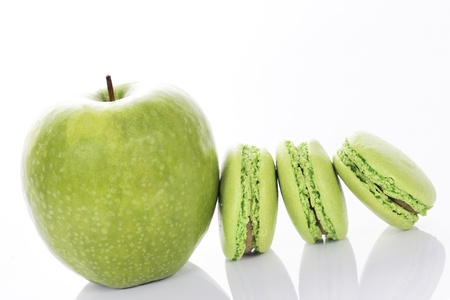 apple with macaroons on white background photo