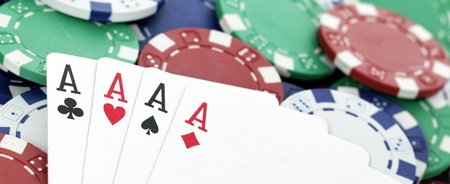 four of a kind: chips and four aces of a kind, panoramic image
