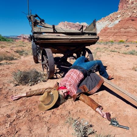 dead woman: dead cowgirl lying on the floor, western spirit Stock Photo