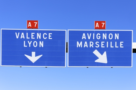 french way: A French road sign pointing the way to marseille, valence, avignon and lyon. Stock Photo