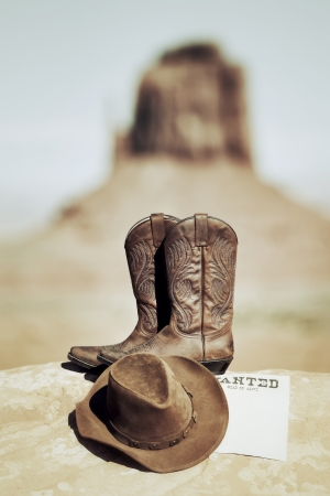 wanted poster, boots and hat in Monument Valley photo