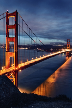 Golden Gate Bridge and San Francisco lights at sunset Stock Photo