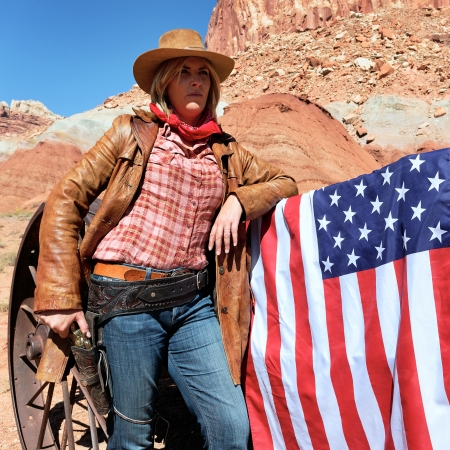 portrait of a blond cowgirl with american flag photo