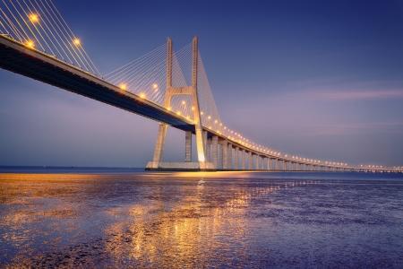 sunrise on Vasco da Gama bridge in Lisbon, Portugal