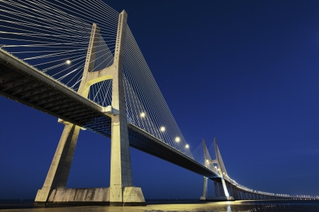 lisbonne: Vasco da Gama bridge in Lisbon by night, Portugal  Stock Photo