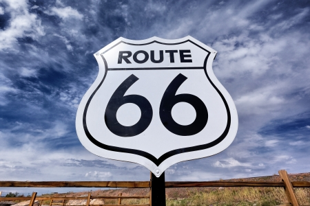 itinerary: An old, nostalgic route 66 sign and sky