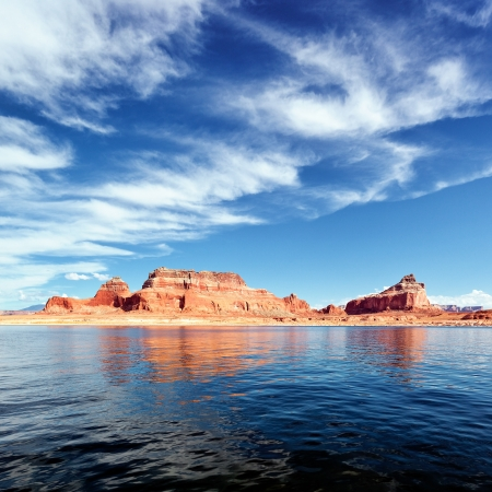 red cliffs reflected in the water of the lake Powell photo