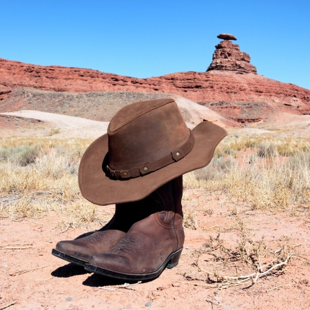 boots and hat in front of famous mexican hat rock photo