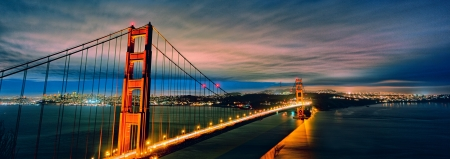 cable bridge: panoramic view of Golden Gate Bridge and San Francisco lights Stock Photo