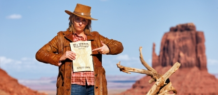 jane: panoramic view of bad cowgirl with wanted paper at Monument Valley