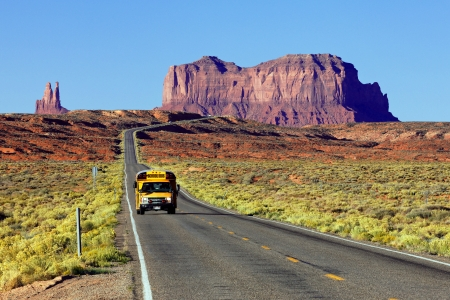 monument valley: school bus on the road at Monument Valley, USA