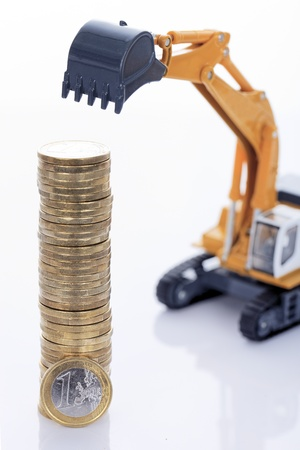 industrie: euro money coins and digger isolated on white background