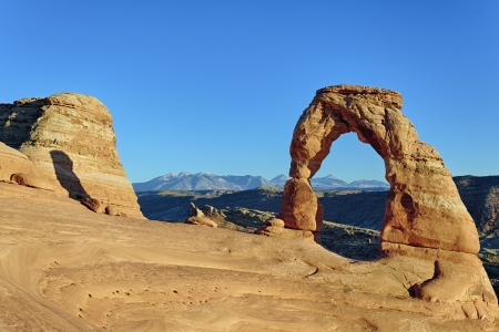 horizontal view of sunset at Delicate Arch, USA photo