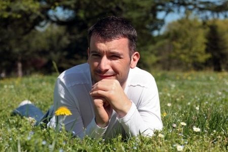 man lying on the grass in a park in spring Stock Photo - 17186850
