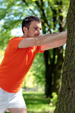 attractive man doing sport in a park photo
