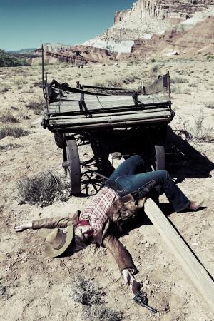 dead woman: dead cowgirl lying on the floor, western style
