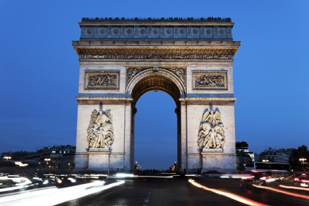 triumphal: The famous Arc de Triomphe by night, Paris, France