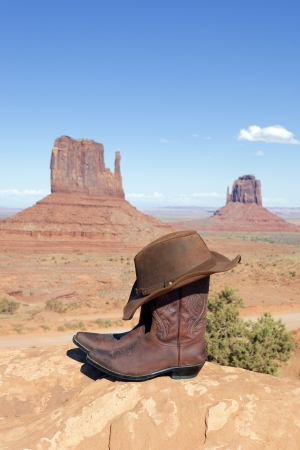 boots and hat in front of Monument Valley, USA photo