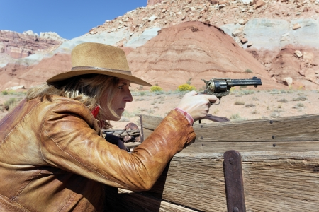 cowgirl with a gun in the hand, ready to shoot Stock Photo - 17412317