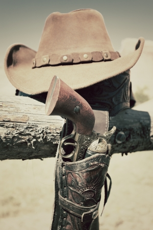 munition: cowboy gun and hat outdoor in a ranch
