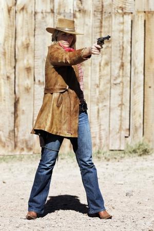 bad girl shooting with a gun  photo