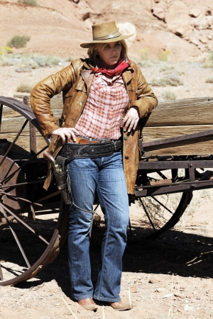 Portrait of blond cowgirl. Western movie style  photo