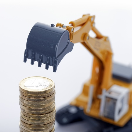 industrie: euro money coins with digger on white background