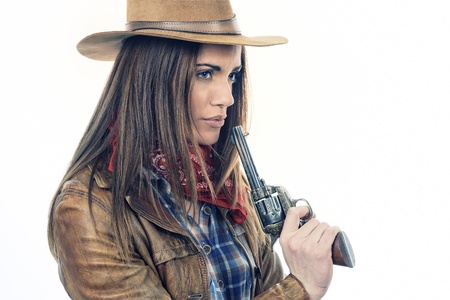 Attractive cowgirl on white background photo
