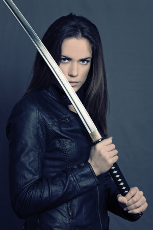 warrior woman: Girl with Katana in studio Stock Photo