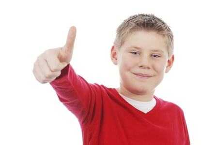 Young boy giving you thumb up isolated on white background  photo