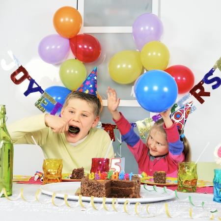novelties: Two children at big birthday party