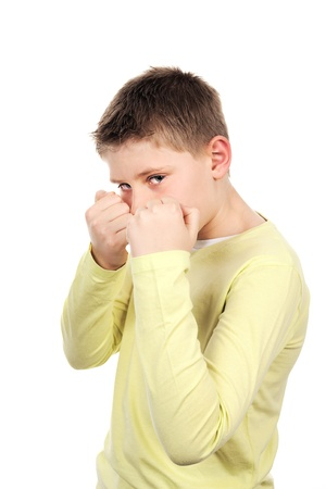 combative: combative young boy in studio Stock Photo