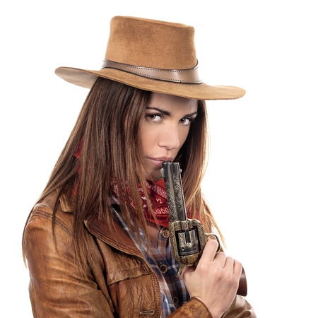 beauty saloon: Attractive cowgirl with gun on white background
